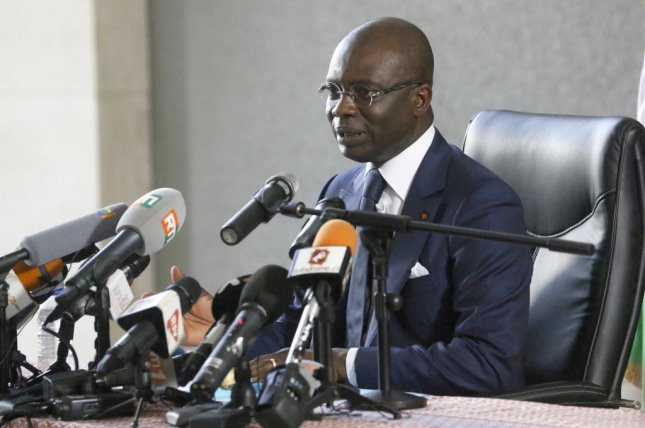 Ivory Coast prosecutor Adou Richard speaks during a news conference regarding the charges against Guillaume Soro in Abidjan on December 26, 2019. On Wednesday, a court convicted Soros for undermining state security and sentenced him to life in prison. File photo by Legnan Koula/EPA-EFE