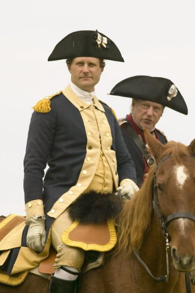 A George Washington reenactor dresses in traditional Colonial army uniform. Photo by Joseph Sohm / Shutterstock