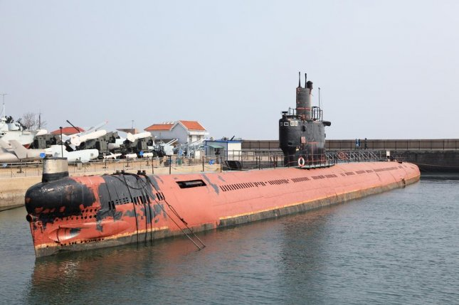 An unidentified Chinese submarine parked at Qingdao harbour, China. Hong Kong press reported China may have dispatched the Jin-class nuclear-powered submarine on its first combat patrol, one week after the Pentagon's Defense Intelligence Agency said China is likely to deploy a submarine carrying ballistic missiles. Photo by mary416/Shutterstock
