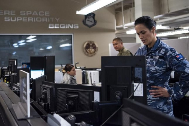 Squadron Leader, Jamiee Maika, of the Royal Australian Air Force operates at the CSpOC at Vandenberg Air Force Base, Calif., in August. Photo by Sgt. J.T. Armstrong/U.S. Space Force