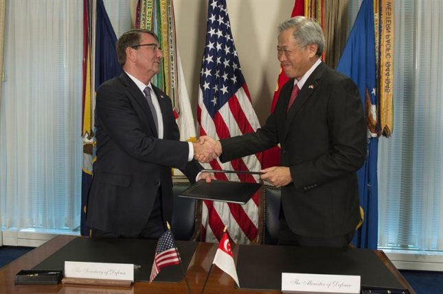 The United States deployed a P-8 Poseidon spy aircraft to Singapore for the first time on Monday, seen as the latest response by the U.S. military against China's claims over territory in the South China Sea. U.S. Secretary of Defense Ashton Carter met with Singaporean Minister of Defense Ng Eng Hen on Monday in the Pentagon to sign an enhanced defense cooperation agreement, also known as a DCA.Photo courtesy of the Department of Defense/Air Force Senior Master Sgt. Adrian Cadiz