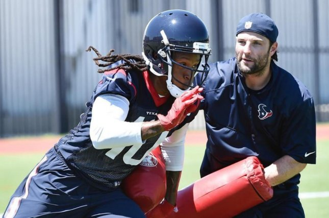 Houston Texans offensive/special teams assistant Wes Welker runs drills with wide receiver DeAndre Hopkins at OTAs. Photo courtesy of the Houston Texans/Instagram