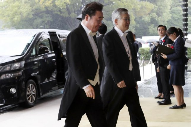 South Korea's Prime Minister Lee Nak-yon (C) arrives at the Imperial Palace to attend the proclamation ceremony of Japan's Emperor Naruhito in Tokyo, Japan, on Tuesday. Photo by Koji Sashara/EPA-EFE