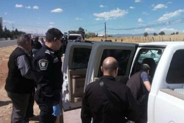 Mexican officials inspect a vehicle used during cartel clashes that killed at least eight suspected gang members, including including César El Cabo Raúl Gamboa Sosa -- a leader of the Juárez Cartel's armed La Línea branch. Officials believe the clashes on Sunday and early Monday occurred due to infighting within the Juárez Cartel. Photo courtesy of Chihuahua Attorney General