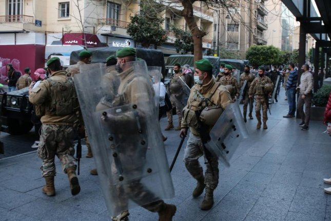Lebanese army soldiers, shown guarding an area during a demonstration on February 26, face the prospect of not getting paid, as well as increased citizen uprisings. Photo by Nabil Mounzer/EPA-EFE
