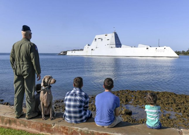 Spectators watch the guided-missile destroyer USS Zumwalt pull into Joint Base Pearl Harbor-Hickam in Hawaii on Wednesday. Photo by Mass Communication Specialist 1st Class Holly L. Herline/U.S. Navy