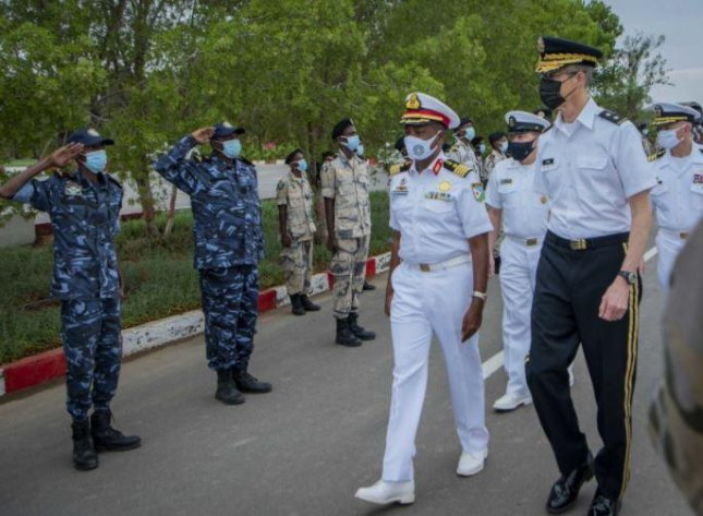 Col. Ahmed Daher Djama of the Djibouti Navy, C, walks with Gen. William Zana, U.S. Combined Joint Task Force-Horn of Africa commanding general, after the opening ceremony of exercise Cutlass Express 2021 on Monday in Djibouti. Photo by Senior Airman Dwane R. Young/U.S. Air Force