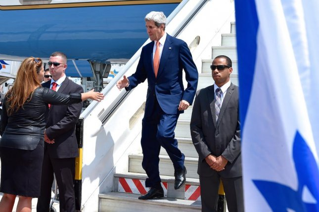 U.S. Secretary of State John Kerry prepares to shake the hand of Israeli Protocol official Orit Moshe at Ben Gurion International Airport on July 23, 2014, as he arrives in Tel Aviv, Israel, for talks with Israeli and Palestinian leaders about a ceasefire in fighting with Hamas in the Gaza Strip. (Flickr/State Department)
