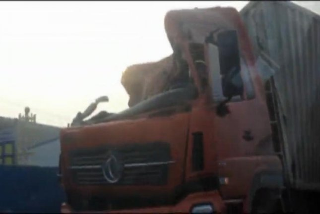 This picture shows several gaping holes in the truck's trailer. Newsflare video screenshot