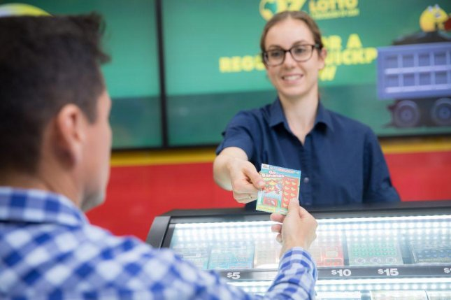 An Australian woman won her second top prize from a scratch-off lottery ticket in three years. Photo courtesy of The Lott