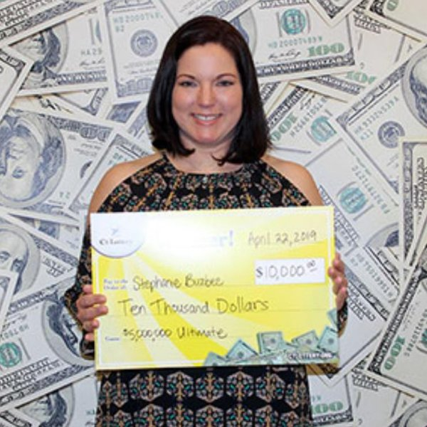 A Connecticut woman said buying scratch-off lottery tickets along her boyfriend's bread delivery route led her to a $10,000 jackpot. Photo courtesy of the Connecticut Lottery
