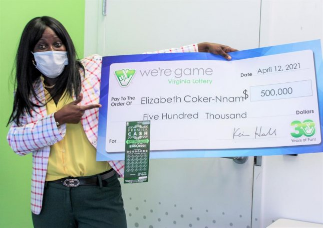 Elizabeth Coker-Nnam of Upper Marlboro, Md., won $500,000 from a Virginia Lottery scratch-off ticket her brother gave her as a late birthday present. Photo courtesy of the Virginia Lottery