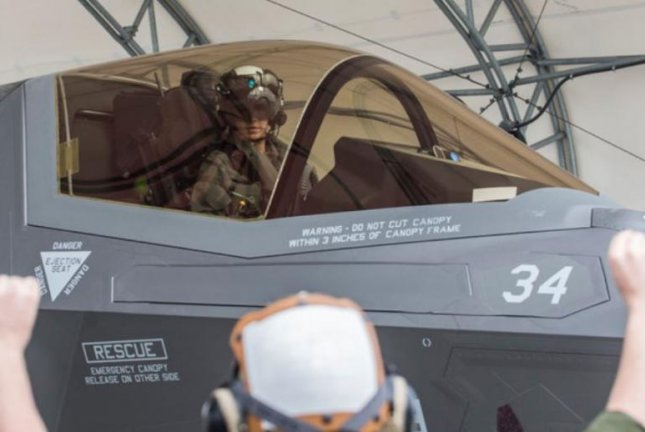 Capt. Anneliese Satz is the first female member of the U.S. Marine Corps to complete the basic course in flying the F-35B Lightning II Joint Strike Fighter plane. She will be deployed to Iwakuni, Japan. Photo by Sgt. Ashley Philips/U.S. Marine Corps