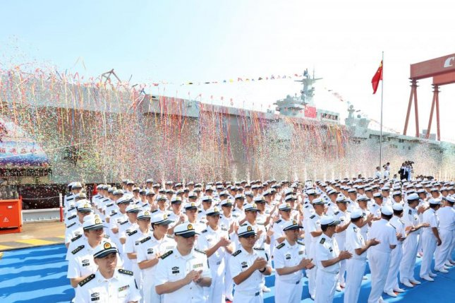 China's first domestically developed and constructed Type 075 amphibious assault ship is launched in Shanghai on Wednesday. Photo by Li Tang/Ministry of National Defense of the People's Republic of China