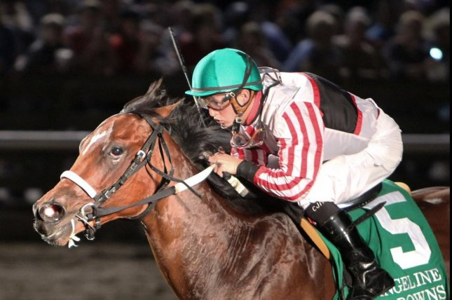 Cale's Gold, under Colby Hernandez, wins the 7/11 D.S. Shine Young Futurity at Evangeline Downs. (Coady Photography)