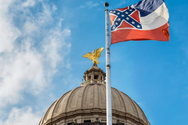 The Mississippi flag flies over the state capitol in Jackson. Photo: Rob Hainer / Shutterstock