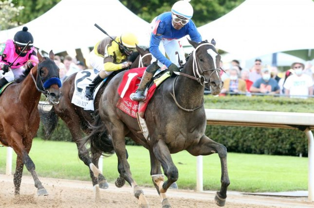 Super Stock wins Saturday's Arkansas Derby is a mild upset, earning a spot in the Kentucky Derby. Photo by Coady Photography, courtesy of Oaklawn Park