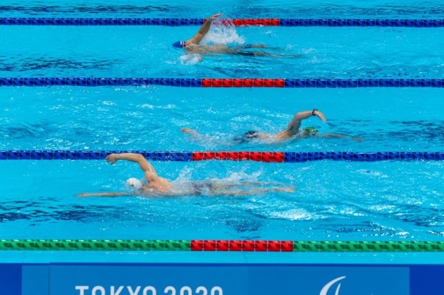 This photo provided by the Olympic Information Service shows a training session Saturday in the Tokyo Aquatics Center ahead of the swimming events at the Tokyo 2020 Paralympic Games. EPA-EFE