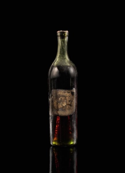 A bottle of cognac dating from 1762 fetched a top bid of $146,000 in an online auction. Photo courtesy of Sotheby's
