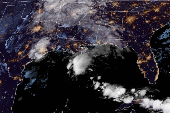 Tropical Storm Beta is seen over southeastern Texas early Tuesday. The storm is expected to move slowly to the northeast Tuesday and Wednesday, ultimately weakening to a depression. Image courtesy NOAA/NHC