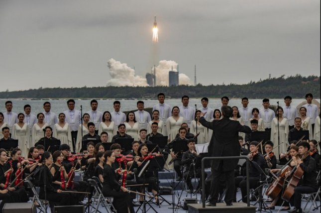 Members of the Xian Symphony Orchestra and Chorus perform during the launch of the Long March 5B rocket carrying China's Tianhe space station core module from the Wenchang Spacecraft Launch Site in Hainan Province, China, on April 29. Photo by Matjaz Tancic/EPA-EFE