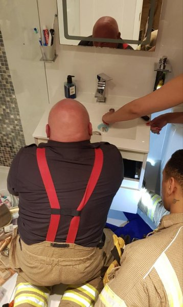 Firefighters in Britain responded to a home in London where a woman's finger was stuck in the overflow drain pipe of her bathroom sink. Photo courtesy of the London Fire Brigade