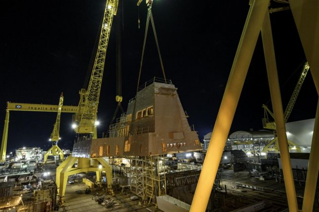 Two cranes were used to lift the 320-ton aft deckhouse onto guided missile destroyer Jack H. Lucas at Ingalls Shipbuilding in Pascagoula, Miss. Photo by Lance Davis/HII