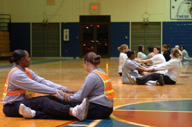Soldiers with the 13th Sustainment Command conduct stretching exercises in at the Kieschnick Physical Fitness Center as a part of the command's Pregnancy/Postpartum Physical Training program in this 2009 photo. Photo byRob Strain/U.S. Army