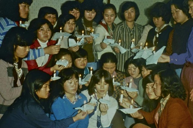 South Korean assembly line workers formed labor unions to protest unfair working conditions. Here, in this 1980 photo, women workers at a wig factory celebrate a union member's birthday. Photo courtesy of Bae Ok-byoung