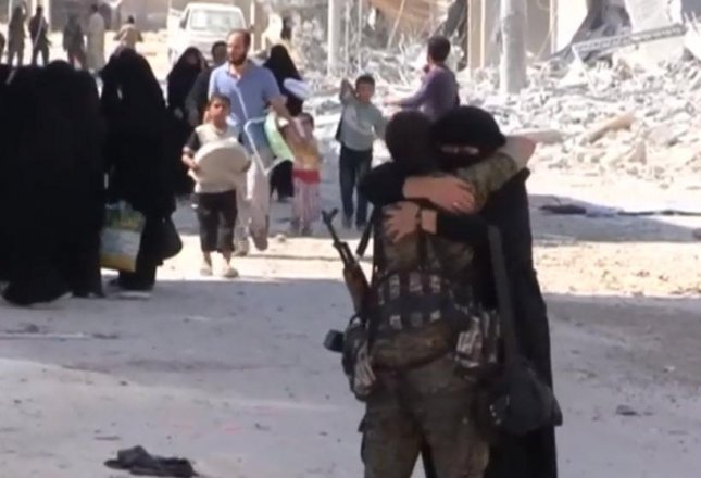Residents of the Syrian town of Manbij rejoiced after United States-backed Kurdish and Arab fighters liberated the area from Islamic State control. The loss of the town also blocked the IS's route to travel to and from Europe.  Screen capture/Sky News/Inform Inc.