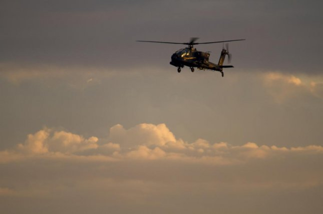 An Apache helicopter, such as the one pictured, crashed into Galveston Bay Wednesday afternoon during a routine training mission, killing two soldiers aboard the aircraft, according to the Texas Army National Guard. Photo by Spc. Scott Lindham/U.S. Army