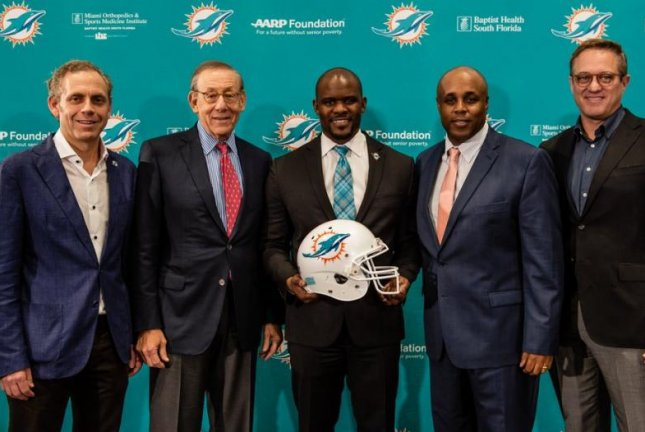 The Miami Dolphins officially hired former New England Patriots assistant coach Brian Flores (C) as the franchise's next head coach. Photo courtesy of Miami Dolphins/Twitter