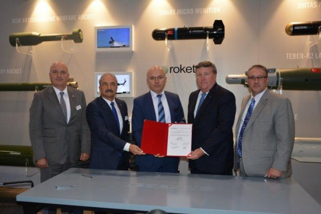Representatives from Lockheed Martin and Roketsan of Turkey signed a contract to cooperatively develop the SOM-J air-to-surface cruise missile for international operators of the F-35. Photo courtesy Roketsan