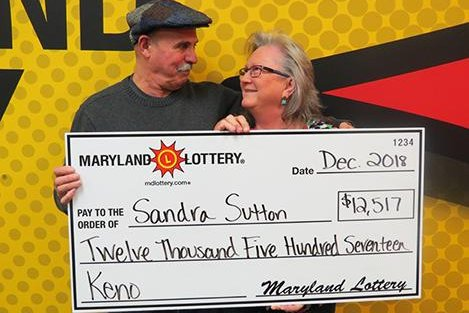 A Maryland couple won their third big Maryland Lottery Keno prize because they were early for a Christmas party. Photo courtesy of the Maryland Lottery