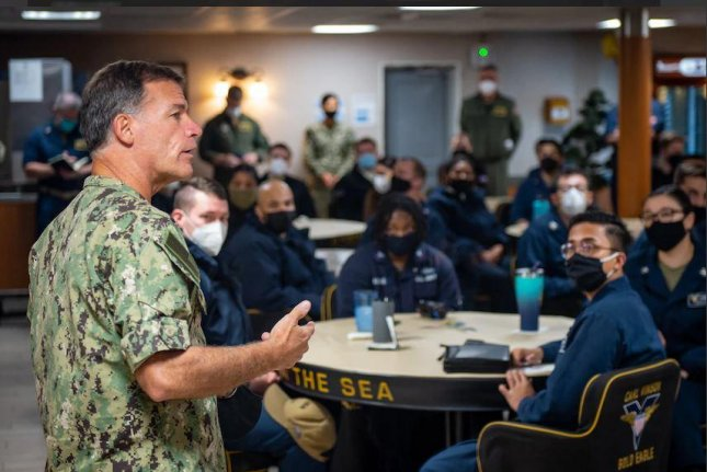 U.S. Pacific Fleet Commander Adm. John Aquillino addresses sailors aboard the USS Carl Vinson after Chief of Naval Operations Adm. Mike Gilday ordered a stand down to address issues of extremism within the Navy. Photo by MCS Mason Congleton/U.S. Navy