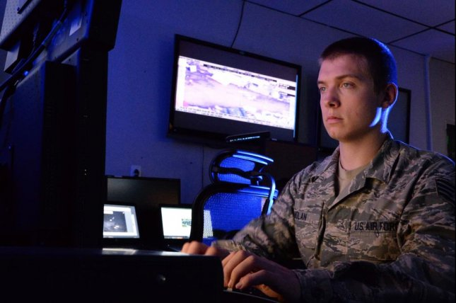 BAE Systems' new contract aims to make information transfers more secure. Pictured: A U.S. Air National Guard Airman checks satellite images. U.S. Air National Guard photo by Senior Airman Lonnie Wiram