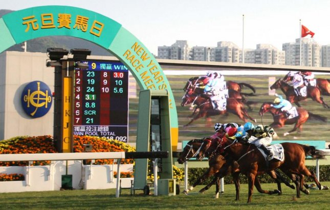Rewarding Hero (outside) wins New Year's Day feature at Sha Tin in Hong Kong and will look for a bigger prize. (HKJC photo)