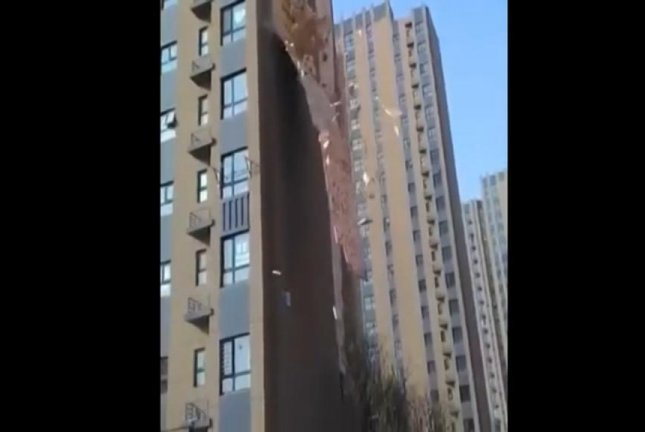 External wall peels from side of Chinese high-rise