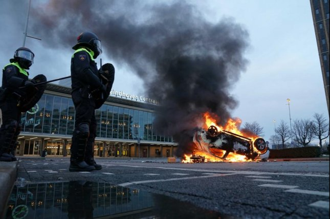 A car burns in front of the station on the 18 Septemberplein in Eindhoven, the Netherlands, after a far-right anti-Islam movement Pegida protest Sunday. Photo by Rob Engelaar/EPA-EFE