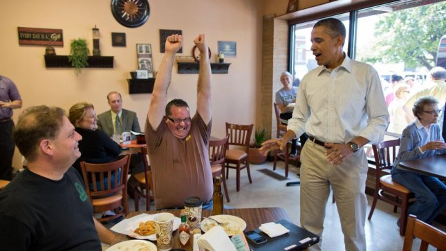 White House photographer Pete Souza happened to capture the moment on August 14 in Knoxville, Iowa, when Brad the Beer Guy Magerkurth found out he would receive a bottle of the White House Honey Ale. Magerkurth later auctioned the bottle for charity for $1,200. (White House/Pete Souza)
