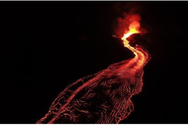 This view of Hawaii's Kilauea Volcano Fissure 8 and the upper lava channel shows roiling lava fountains remaining within the cinder cone and a flowing incandescent channel on Tuesday. Photo courtesy of USGS