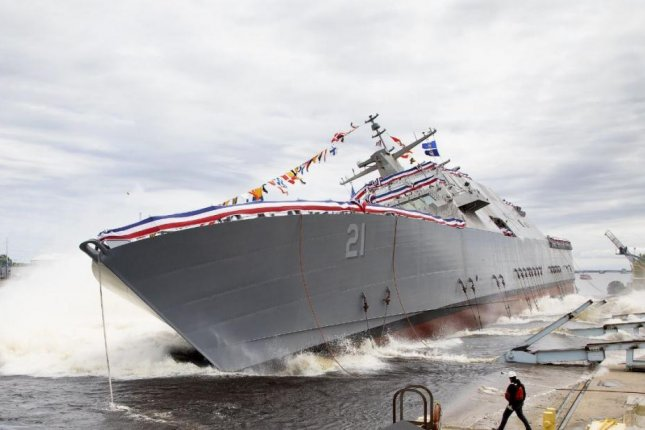 The littoral combat ship USS Minneapolis-St. Paul, seen here during its June launch, will return to the site of its construction in Wisconsin for post-delivery support. Photo courtesy of Lockheed Martin
