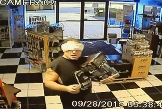 Police said the so-called Maxi Pad Bandit broke into Battery Mart in Apple Valley, Calif., Monday evening. KNBC-TV video screenshot