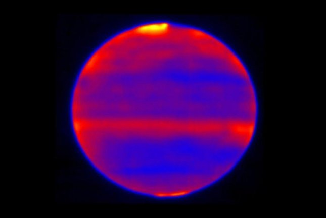 Researchers used the Subaru Telescope's Cooled Mid-Infrared Camera and Spectrograph to capture infrared images of Jupiter's polar auroras. Photo by NAOJ/NASA/JPL-Caltech