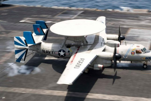 An E-2D Hawkeye of the U.S. Navy sits aboard an aircraft carrier. On August 9, a similar aircraft attempted to land aboard the USS Abraham Lincoln, striking two F/A-18 Super Hornets, and debris damaging two others. Photo by MCS3 Dan Snow, U.S. Navy