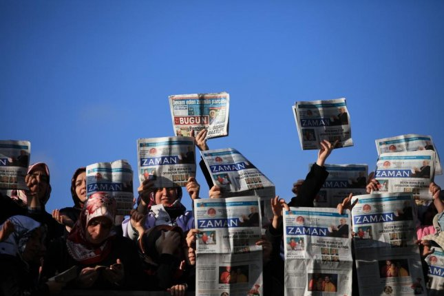 Protesters surround the Zaman newspaper office building in December after a police raid failed to detain the editor in December 2014. Protesters have again surrounded the Zaman building after the Turkish government took control of the entire outlet this week. Photo by Sadik Gulec/Shutterstock