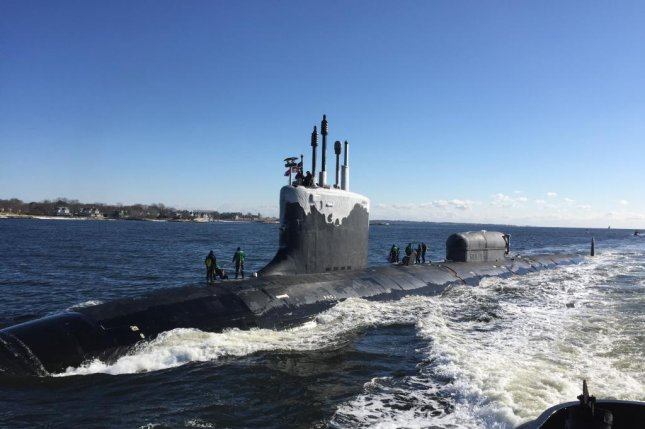 The USS North Dakota, a Virginia-class attack submarine, transits the Thames River in Europe on January 31 en route to its homeport at Naval Submarine Base New London in Groton, Conn. The U.S. Navy's fleet includes 17 ships in the class. Photo by Cmdr. Jason M. Geddes/U.S. Navy