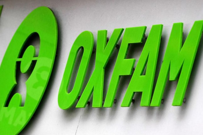 The Oxfam logo is shown at a store in London on February 14, 2018. The charity said it has suspended two aid workers as part of an investigation in the Democratic Republic of Congo. Photo by Andy Rain/EPA-EFE