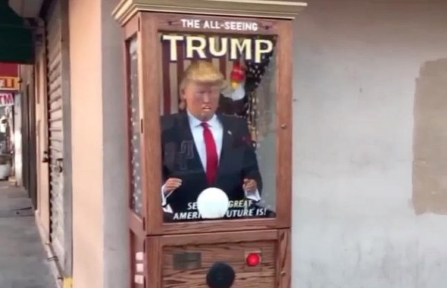 An All-Seeing Trump fortune-teling machine featuring an animatronic, talking Donald Trump has appeared in various locations across New York City. Screen capture/PIX11/AOL