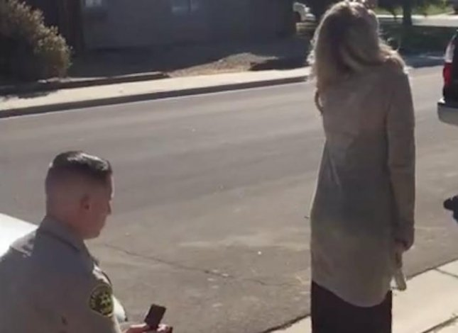 A California sheriff's deputy planned an elaborate surprise engagement proposal by staging a fake DUI.  Screen capture/Palmdale Sheriff's Station/Facebook